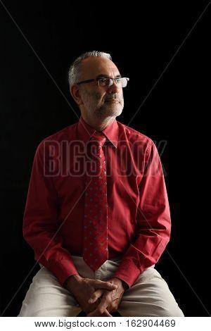 Portrait of an elegant mature man on black