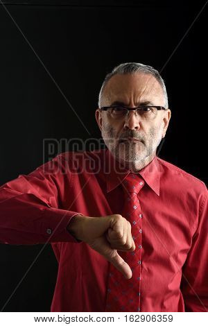 Man with thumb down with black background