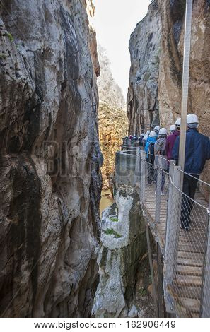 Visitors walking along the footbridge of Caminito del Rey path Malaga Spain