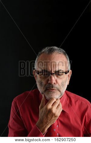 portrait of a distressed man with black background