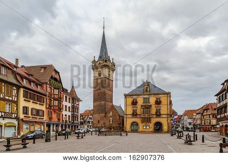View of main square in Obernai with Kapellturm tower and town hall Alsace France