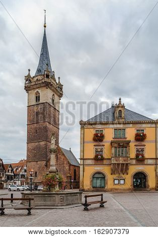 Kapellturm tower and town hall on main square in Obernai Alsace France