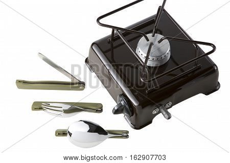 Set for the tourist. A spoon a fork a knife and portable gas stove on a white background