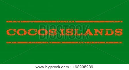 Cocos Islands watermark stamp. Text caption between horizontal parallel lines with grunge design style. Rubber seal stamp with dust texture. Vector orange color ink imprint on a green background.