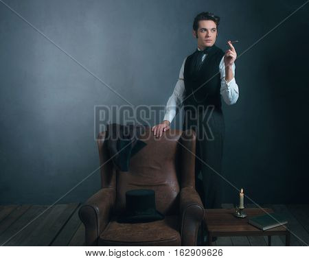 Vintage Victorian Man Standing Next To Chair Smoking Cigarette.
