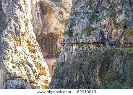Visitors walking along the footbridge of Caminito del Rey path Malaga Spain