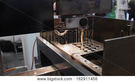 Cutting of metal. Sparks fly - laser processing at industry, close up
