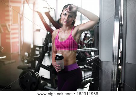 Young Fitness Woman Tired In Gym Hold Shaker With Sportive Nutrition - Protein Of Shaker
