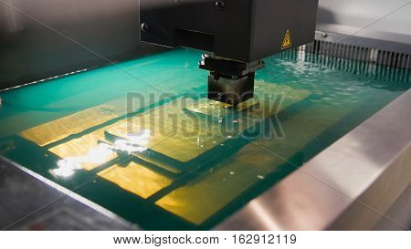 Automatic factory - cutting of sheet metal process in water, close up