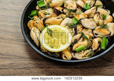 Mussels and vegetables cooked in a rustic style.