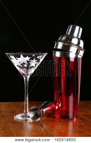 Martini glasses with red cocktail shaker and stainless steel jigger