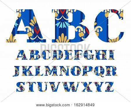 English alphabet, gold flowers, vector font, capital letters, and blue. The letters of the English alphabet with serifs. Gold and blue flowers on a dark blue background.