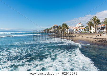Ocean coast in the tourist resort Playa de las Americas Tenerife island Canary Islands Spain winter sun travel