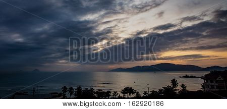 A cloudy sunrise over the south china sea and vinpearl island Vietnam.
