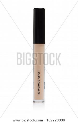 Light beige color liquid concealer bottle, used for covering blemish on the skin, isolated on white background