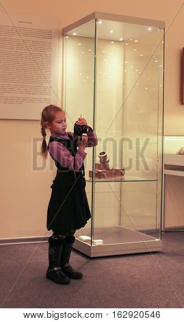 Gatchina, Russia - 3 December, Little photographer in the museum, 3 December, 2016. Visit the Museum Reserve Gatchina Palace.