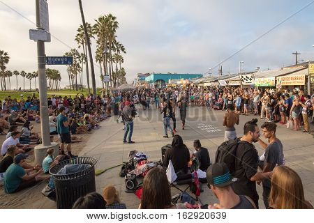 Los Angeles, USA - October 22: Buskers and crowd at Venice Beach in Los Angeles, California, USA