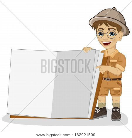 cute little explorer boy in a safari outfit showing a giant book open