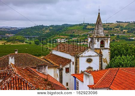 Old Catholic church architecture in Obidos, Portugal