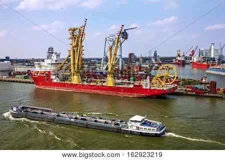 Rotterdam, Netherlands - May 30, 2016: Port: cargo vessels in Rotterdam port