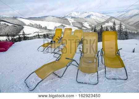 chaise lounges in winter resort Jasna, Slovakia