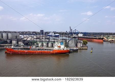 Rotterdam, Netherlands - May 2, 2016: Cargo vessel in sea port Rotterdam