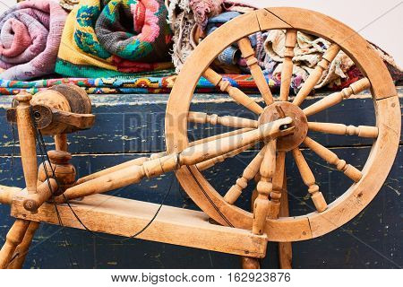 Wooden loom and woven textiles, handmade closeup
