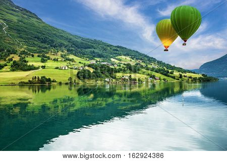 Country landscape, Olden, Norway. Hot air balloons