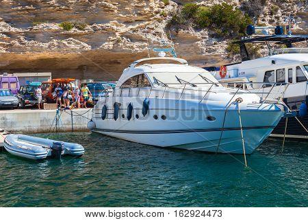 Ordinary Tourists Boarding On Pleasure Boat