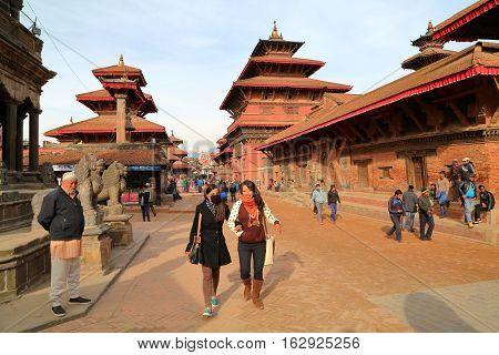 PATAN, NEPAL - DECEMBER 19, 2014: The main street along the temples at sunset at Durbar Square