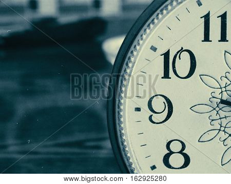 Old clock on the table retro vintage background view closeup time generation fashion 50s 60s 70s 80s