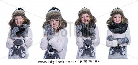 Happy cute kid posing in the studio. Wearing winter clothes. Knitted woolen sweater and mittens. Ear flaps fur cap. Isolated on white background. Composite image