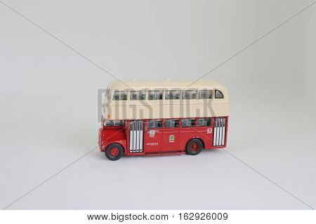 the bright red traditional bus isolated over white