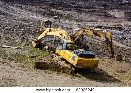 Construction machinery. Excavation work at the construction site.