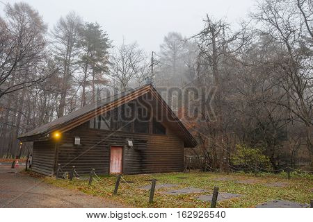 Woodhouse with tree anf fog at Karuizawa Japan