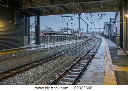 TOKYO, JAPAN - 20 NOV 2016 : Train platfrom at Karuizawa Railway station at night. The railway system is one of the most important public transportation in Japan.
