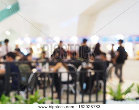 Abstract blurred background of food court with people