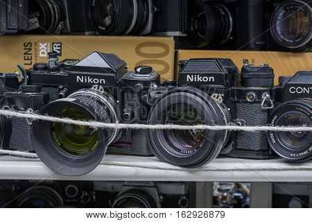 TOKYO - 21 NOV 2016 : Used camera in a shop at Akihabara area in Tokyo, Japan. The area is a major shopping area for electronic, telecommunication, computer, anime, games and otaku goods.