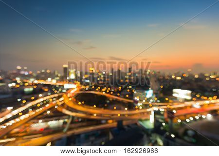 Blurred light aerial view highway intersection skyline abstract background