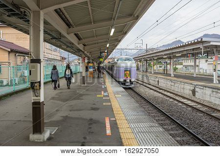 TOKYO, JAPAN - 20 NOV 2016 : Train stopped at Fujikyu Railway station.The railway system is one of the most important public transportation in Japan.