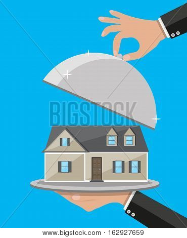 Hand opens serve cloche with house inside. present concept. vector illustration in flat design on blue background.