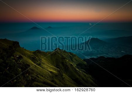 Stratovolcano And Mountains In Morning Fog