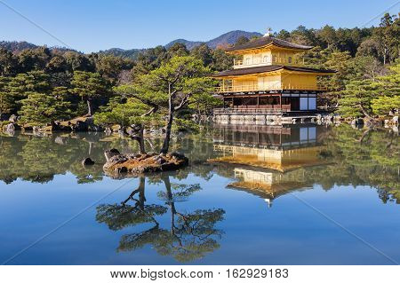 Golden Pavilion at Kinkakuji Temple with reflection and clear blue sky background, Kyoyo Japan