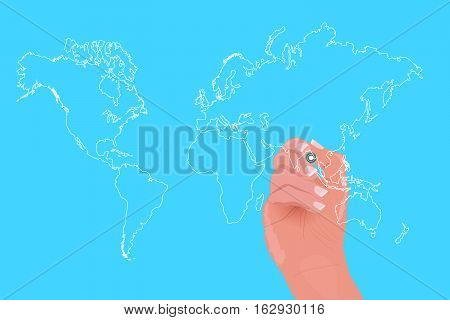 Hand drawing a world map with a white marker.
