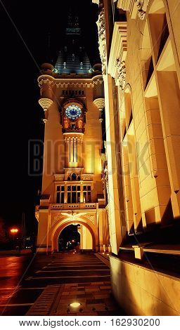 Night view at the palace of culture clock tower. Architectural edifice in Iasi Romania.