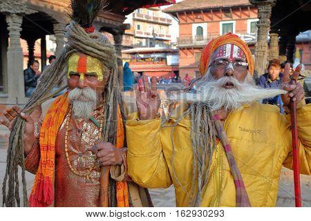 PATAN, NEPAL - DECEMBER 21, 2014: Portrait of two Sadhus (Holy men) at Durbar Square