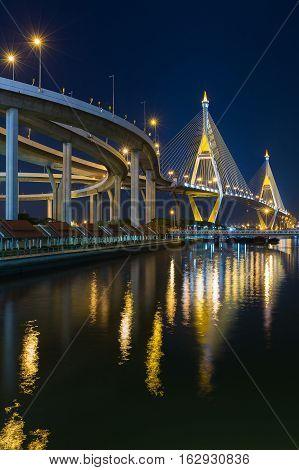 Twin suspension bridged crossing Bangkok river at twilight, Thailand
