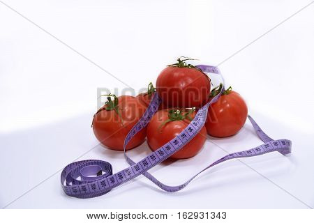 Abstract composition of Diet. Tomatoes with blue centimeter in.