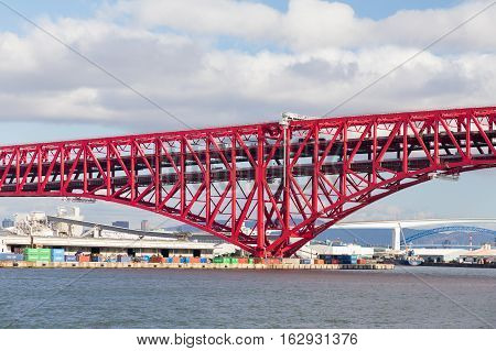 Red double-deck cantilever truss bridge, Minato Bridge in Osaka Japan