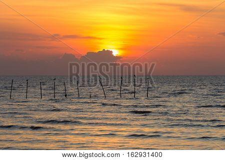 Sunset over seacoast, natural seascape landscape background